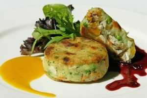 Turkey ham potato cake with pumpkin dressing and cranberry sauce. Photo / Richard Robinson