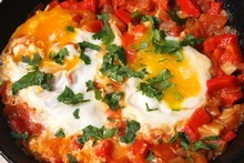 Shakshuka - poached eggs in tomato sauce - is a Tunisian speciality. Photo / Thinkstock
