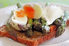 The first fresh spears of asparagus with grain bread and poached eggs is a surefire recipe for bliss. Photo / Doug Sherring