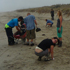 Cleanup crews work hard to remove the oil as it washes up. Photo / Sandy Gorringe