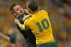 There is certainly no love lost between Richie McCaw and Quade Cooper. Photo / Getty Images