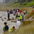 Containers wash ashore as clean-up crews and locals are seen on Mount Maunganui beach. Photo / Jamie Troughton/Dscribe Journalism