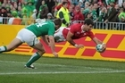 Welsh halfback Mike Phillips scores his teams second try during the first quarter-final against Ireland. Photo / Paul Estcourt
