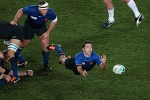 France's Dimitri Yachvili still has heavy bruising on a thigh after the quarter-final win over England at the weekend. Photo / Richard Robinson