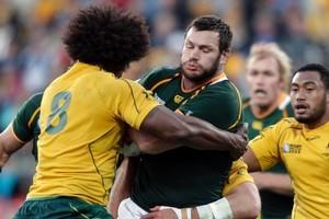South Africa's Danie Rossouw crashes into Australia's Radike Samo. Photo / Mark Mitchell