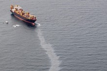 The slow response to the escape of oil from the container ship Rena has shocked many New Zealanders. Photo / APN
