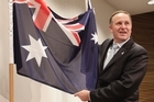 John Key stands next to an Australian flag after losing a bet on the Warriors to Australian Prime Minister Julia Gillard. Photo / Mark Mitchell