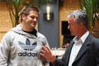 All Black Captain Richie McCaw (L) talks with 1987 All Black Terry Wright (R). Photo / Getty Images