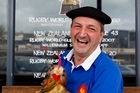 French supporter Louis Bouquet with his rooster named Cocorico. Photo / Dean Purcell