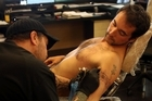 Michael Sokolich tattoos Pierre Crequis. Photo / Janna Dixon