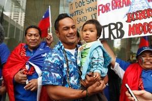 Eliota Fuimaono-Sapolu holding his nephew Samuel Sapolu-Palu and fans. Photo / Amos Chapple