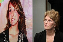 Lesley Elliott (R), mother of murdered 22-year-old Sophie Elliott, sits beside a poster that carries an image of her daughter. Photo / Sarah Ivey