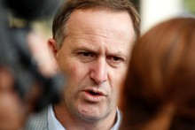 John Key made excuses on behalf of the rescue agencies when the Rena foundered last week. Photo / Christine Cornege