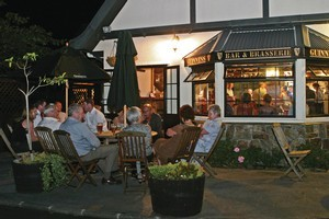 Patrons enjoy an evening outside the Salty Dog Inn. Photo / Supplied