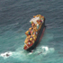 An aerial view of the container ship Rena which is stuck on Astrolabe Reef. Photo / Alan Gibson