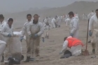 Soldiers from the NZ Army are helping Maritime NZ with efforts to clean Bay of Plenty beaches after the shipwreck of the Rena.