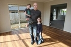 Craig Fellows and his children Grace, 6, and Cooper, 5, at home in Ohauiti. Their household goods and car are on Rena. Photo / Joel Ford/Bay of Plenty Times