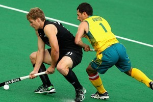 Jamie Dwyer of the Kookaburras competes with Steve Edwards. Photo / Getty Images