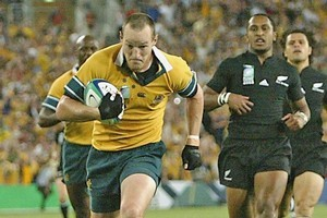 Stirling Mortlock scores against the All Blacks in the 2003 Rugby World Cup semifinal. Photo / Getty Images