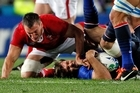 Vincent Clerc is taken in a high tackle by Wale's Sam Warburton. Photo / Dean Purcell