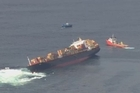 Mark Mitchell looks at the Rena oil spill wreckage in the Bay of Plenty from the air.
