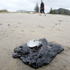 Oil from the stricken container ship, MV Rena which is stuck on Astrolabe Reef, off Motiti Island, Bay of Plenty has washed up along the coast in Mount Maunganui. Photo / Bay of Plenty Times