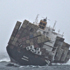 Rena is seen on an angle after high seas bashed the boat and caused containers to fall. Photo / NZDF