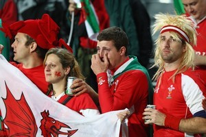 Wales fans show their emotions after the defeat to France. Photo / Getty Images