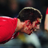 A bloodied George North of Wales is directed off the pitch by teammate Stephen Jones. Photo / Getty Images