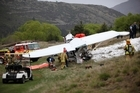 Emergency workers tried to save Ian Douglas Sloan after the crash at an Arrowtown golf course. Photo / Getty Images