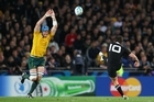 Aaron Cruden drops a goal against the Wallabies last weekend. Photo / Getty Images