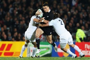 Sonny Bill Williams is tackled by Maxime Mermoz and Dimitri Szarzewski of France. Photo / Getty Images