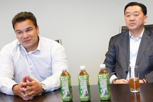 Michael Jones (left) had a noni juice deal with Natural Dairy chief Jack Chen, who has been charged with businesswoman May Wang. Photo / Richard Robinson