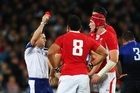 Wales captain Sam Warburton (hidden) receives a straight red card from Referee Alain Rolland of Ireland. Photo / Getty Images