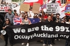 The Occupy Auckland march makes its way up Queen Street before setting up in Aotea Square. Photo / Amos Chapple