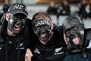 All Blacks fans celebrate the win. Photo / Brett Phibbs