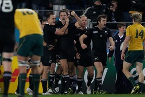 The All Blacks celebrate at the final whistle. Photo / Brett Phibbs