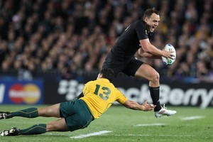 All Black fullback Israel Dagg leaps over Australia's Anthony Fainga'a during last night's semifinal at Eden Park. Picture / Greg Bowker