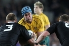 All Blacks Owen Franks and Kieran Read tackle Australia's captain James Horwill. Photo / Greg Bowker