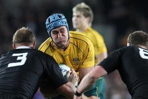 All Blacks Owen Franks and Kieran Read tackle Australia's captain James Horwill. Photo / Greg Bowker