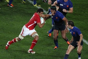 Wales player Toby Faletau is tackled by France's Captain Thierry Dusautoir. Photo / Greg Bowker