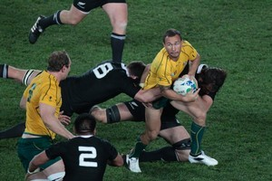 Wallaby Quade Cooper in action against the All Blacks during the semifinal at Eden Park. Photo / Richard Robinson