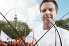 Grove head chef Ben Bayly with crayfish destined to become culinary delights at the Taste of New Zealand festival. Photo / Greg Bowker