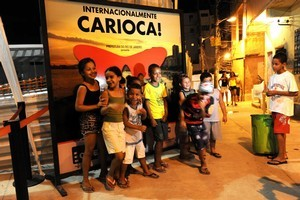 Children outside the CineCarioca movie theatre in the Rio de Janeiro slum that was once the haunt  of the city's biggest drug gang. Photo / AP
