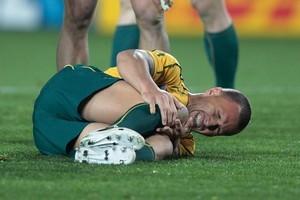 Australia's first-five Quade Cooper hurts his knee. Photo / Brett Phibbs