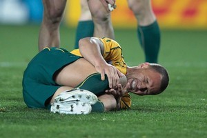 Quade Cooper writhes in agony after twisting his right knee midway through the first half. Photo / Brett Phibbs