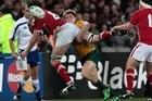 James O'Connor of Australia tackles Ryan Jones of Wales. Photo / Brett Phibbs