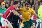 Australia's Digby Ioane tries to shrug off a Welsh defender.  Australian fans. Photo / Natalie Slade