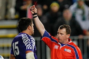 Referee Nigel Owens, right, shows the red card to Samoa's Paul Williams after he struck South Africa's Heinrich Brussow. Photo / AP