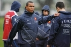 French rugby Captain Thierry Dusautoir warms up with his squad. Photo / Greg Bowker